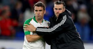 Republic of Ireland captain  Séamus Coleman  and Gareth Bale of Wales  after the Nations League  match  at Cardiff City Stadium. Photograph:  Catherine Ivill/Getty Images
