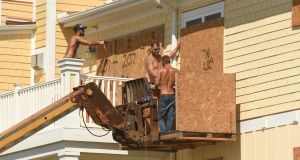 Crew work to board up homes in Oak Island, NC,  in preparation for Hurricane Florence. Photograph: Ken Blevins/The Star-News via AP
