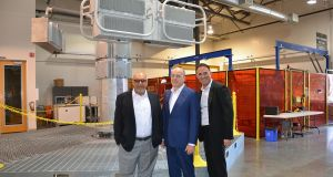 Smart Wires chief executive Gregg Rotenberg, Minister for Communications Denis Naughten and Haroon Inam, Smart Wires CTO, with a live model of the company's power flow control device at their R&D Facility in Union City, California.