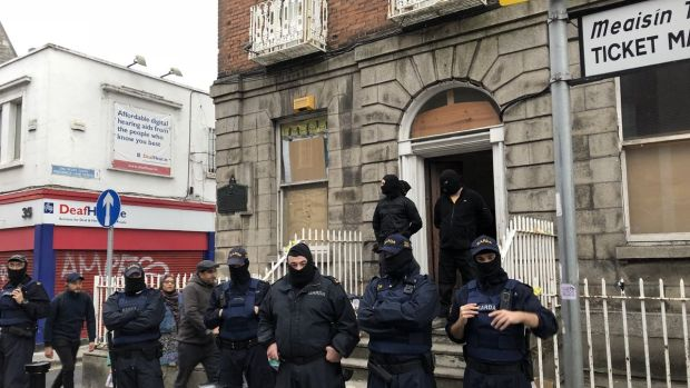 Gardaí and security guards at 34 North Frederick Street on Tuesday night. Photograph: Jack Power
