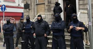 Gardaí were deployed to keep protesters and the masked men apart. Photograph: Jack Power