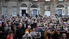 People take part in a protest outside 34 North Frederick St in Dublin's city centre. Photograph: Brian Lawless/PA Wire