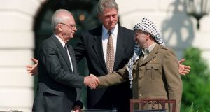 On September 13th, 1993, US president Bill Clinton stands between PLO leader Yasser Arafat and Israeli prime minister Yitzahk Rabin as they shake hands. Photograph: J David Ake/AFP/Getty Images
