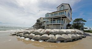 Sand bags surround homes on North Topsail Beach, North Carolina, US, as Hurricane Florence threatens the coast. Photograph: AP Photo/Chuck Burton