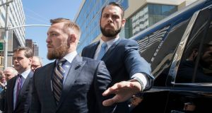 Conor McGregor leaves a Brooklyn Supreme court in  June during plea negotiations to resolve charges stemming from a backstage melee at a Brooklyn arena.. Photograph: AP/Mary Altaffer