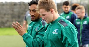 Bundee Aki and Kieran Marmion during Connacht training at the Sportsground. Photograph: Bryan Keane/Inpho