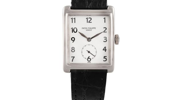 Lot 93, a Gondolo watch by Patek Philippe with a square white face on a black leather strap