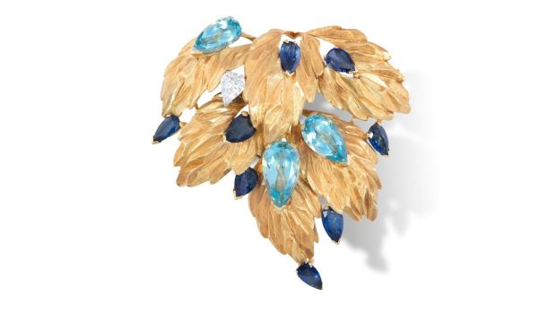 Lot 62, a pear-shaped aquamarine, sapphire and diamond brooch by Andrew Grima