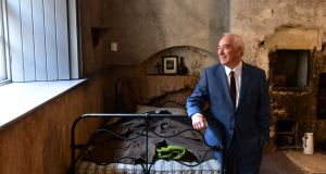 Peter Branigan in the basement room of 14 Henrietta Street, Dublin, where he was born. Photograph: Dara Mac Dónaill