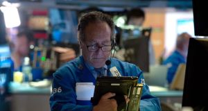 A trader on the floor of New York Stock Exchange. Photograph: Bryan R Smith/AFP/Getty Images