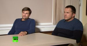 A still image taken from  video footage and released by RT news channel, shows Alexander Petrov and Ruslan Boshirov during an interview, on Thursday, at an unidentified location in Russia.