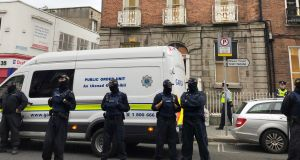 Gardaí from the public order unit attending the scene when a housing crisis protest was brought to an end in Dublin's north inner city on Wednesday. Photograph: Jack Power