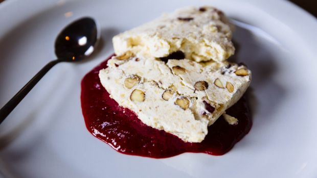 Nougat Glace with raspberry sauce. Photograph: Emma Jervis
