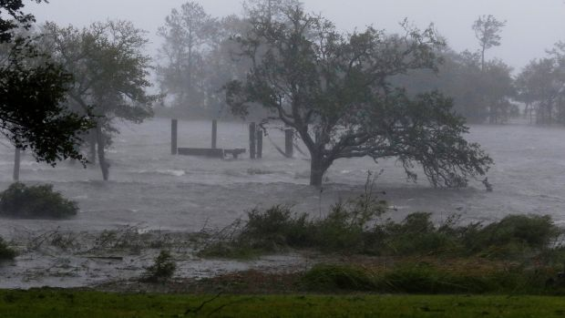 High winds and storm surge from Hurricane Florence hits Swansboro, North Carolina, US. Photograph: AP Photo/Tom Copeland
