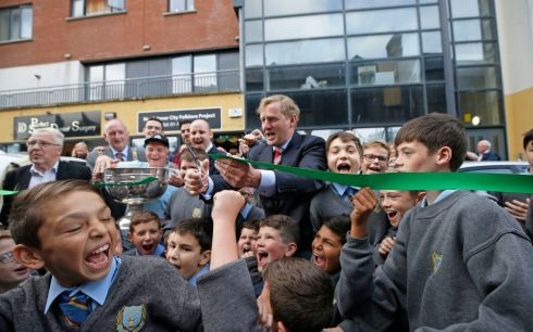 RIBBON CUTTING: Former taoiseach Enda Kenny formally opening the North Inner City Folklore Project/Museum on Railway Street, Dublin 1, with the help of pupils from O'Connell Primary School. The North Inner City Folklore Project was setup in the 1980s to record local people in the community and has built has up an audio and photographic archive. Photograph: Nick Bradshaw/The Irish Times