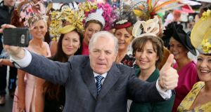 Irish presidential candidate Gavin Duffy amongst the fashion on Ladies Day during day four of the Galway Summer Festival at Galway Racecourse. Photograph: Brian Lawless/PA Wire