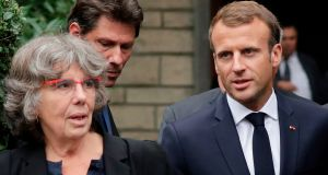 French president Emmanuel Macron with Michele Audin, daughter of late Maurice Audin, as he leaves the home in Bagnolet of Josette Audin, widow of Audin, on Thursday. Photograph: Thomas  SamsoN/AFP/Getty Images