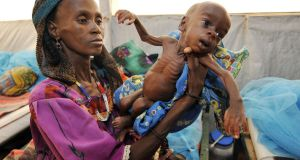 A woman shows her malnourished baby at an intensive nutritional rehabilitation centre  southern Niger. Of the 189 countries in the Human Development Index, Ireland ranked fourth and Niger last. Photograph:  Getty Images