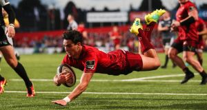 Munster's Joey Carbery scores a try during the Guinness Pro 14 match against Ospreys in Cork. Photograph: Billy Stickland/Inpho