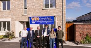 Members of Club Rossie at the Royal Canal Park Development in Ashtown, Dublin 15, where they are raffling off a house.