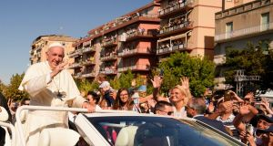 Pope Francis waves as he visits Sicily to pay tribute  to a priest who was slain by mobsters for working to keep youths away from the Mafia. Photograph: Andrew Medichini/AP.