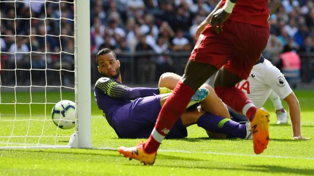 Michel Vorm looks on as Roberto Firmino scores Liverpool's second against Spurs. Photograph: Dylan Martinez/Reuterst