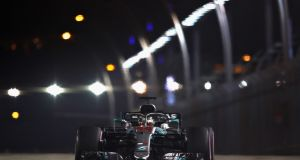 Lewis Hamilton   during qualifying for the  Singapore Grand Prix at the  Marina Bay Street Circuit. Photograph: Lars Baron/Getty Images