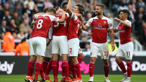 Arsenal celebrate Mesut Özil's goal which put the Gunners 2-0 up against Newcastle. Photograph: Alex Livesey/Getty)