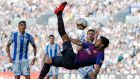 Barcelona's Luis Suarez attempts an overhead kick during the La Liga game against  Real Sociedad at Anoeta Stadium in San Sebastian. Photograph: Paul Hanna/Reuters