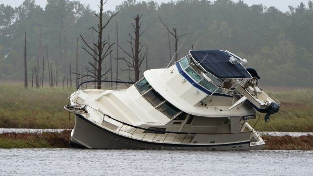 A boat that washed onto a marshy area during Hurricane Florence, in Wilmington, North Carolina. Photograph: Carlo Allegri/Reuters