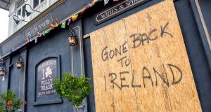 An Irish pub boarded up for  Hurricane Florence in Folly Beach, South Carolina. Photograph: Johnny Milano/New York Times
