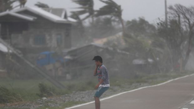 Strong winds batters a villager in the typhoon-hit town of Baggao, Cagayan province, Philippines. Photograph: EPA/FRANCIS R. MALASIG