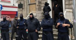 Masked gardaí and private security contractors outside 34 North Frederick Street in Dublin on Tuesday evening. Photograph: Jack Power.