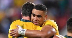 Lukhan Tui (right) hugs Rob Simmons following Australia's loss to Argentina in the Rugby Championship match  at Suncorp Stadium in Brisbane. Photograph: Darren England/EPA