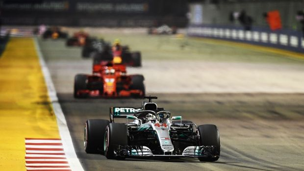 Mercedes' Lewis Hamilton on his way to victory in the Singapore Grand Prix. Photograph: Jewel Samad/AFP/Getty