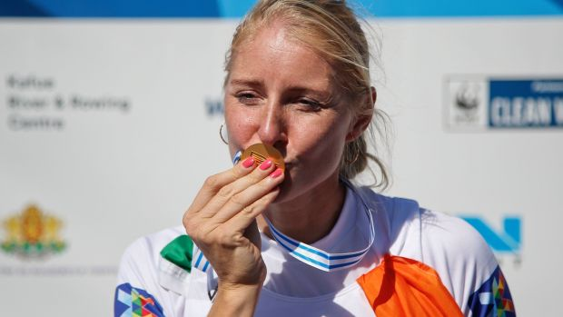 Ireland's Sanita Puspure kisses the gold medal she won in the Women's Single Sculls at the World Rowing Championships in Plovdiv on Sunday. Photograph: Darko Vojinovic/AP.
