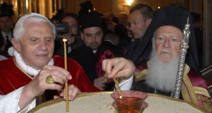 Pope Benedict XVI and Greek Orthodox Ecumenical Patriarch Bartholomew light candles  at a Greek Orthodox  cathedral in Istanbul, 2006. Photograph: Ecumenical Patriarchate/Reuters