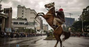 A horse rears in the street as major crowds gather to welcome returning leaders of the once-banned Oromo Liberation Front  in the Ethiopian capital Addis Ababa. Photograph: Mulugeta Ayene/AP Photo