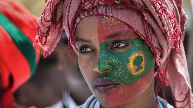 A woman participates in celebrations for the return of the formerly banned anti-government group the Oromo Liberation Front at Mesquel Square in Addis Ababa, Ethiopia. Photograph: Michael Tewelde/AFP/Getty Images