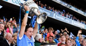 Dublin captain Sinead Aherne lifts the Brendan Martin Cup. Photograph: Sam Barnes/Sportsfile