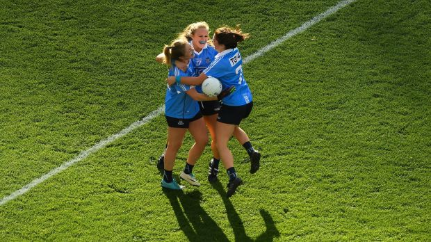 Dublin's Sinéad Finnegan, Amy Connolly, and Niamh Collins celebrate their side's win over Cork. Photograph: Piaras Ó Mídheach/Sportsfile