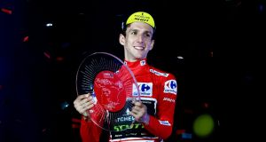 "Britain's  Simon  Yates celebrates on the podium after winning the 73rd edition of ""La Vuelta"" Tour of Spain in Madrid. Photograph: Getty Images"