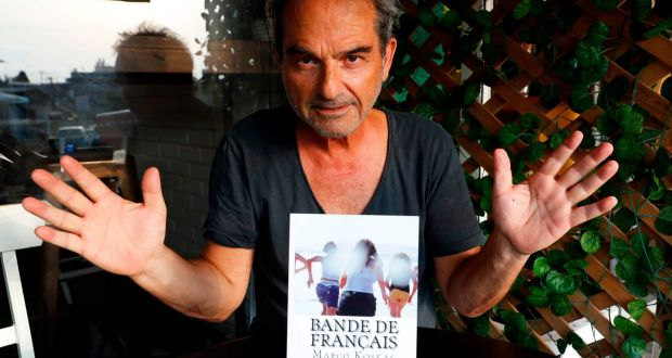 French Israeli writer Marco Koskas with a copy of his book in Tel Aviv. Photograph: Jack Guez / AFP/Getty Images