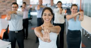 Workplace wellness initiatives include exercise classes and gym passes. Photograph: iStock