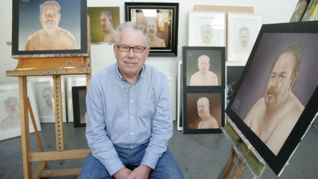 Robert Ballagh with a series of self-portraits at his studio in Stoneybatter. Photograph: Alan Betson