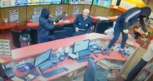 A still image from CCTV footage shows Denis O'Connor (83) confronting armed raiders in Bar One Racing in Cork on Saturday evening.