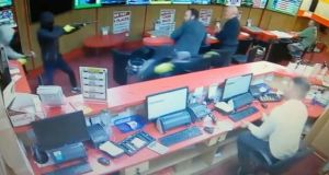 A still image from CCTV footage showing armed raiders entering  Bar One Racing  in Cork on Saturday evening.
