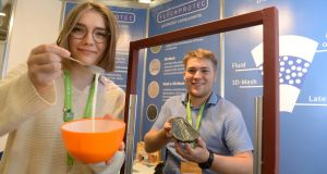 Anna Fleck and her brother Adrian Fleck, from Germany, with their project at the European Union Contest for Young Scientists, at the RDS, Dublin. Photograph: Dara Mac Dónaill
