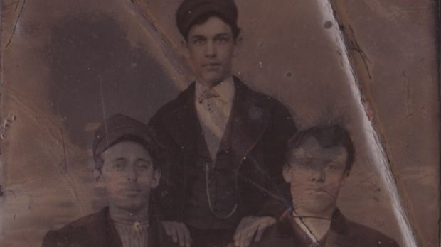 Florence Burke (centre) with his brother John (left), and possibly his cousin Michael at Immigration in New York City.