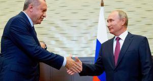 Russian president Vladimir Putin (right) shakes hands with Turkish president Recep Tayyip Erdogan during their meeting in the Bocharov Ruchei residence in Sochi. Photograph: Alexander Zemlianichenko/AFP/Getty Images